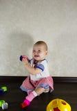игрушки младенца маленькие играя Стоковое Фото