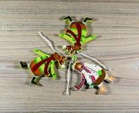 Игрушки на деревянной предпосылке стоковая фотография