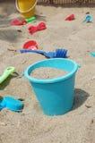 Игрушки пляжа в ящике с песком Стоковое Фото
