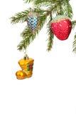 Игрушки рождества на белой предпосылке Стоковое Изображение