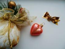Игрушки рождества на белой предпосылке Стоковая Фотография