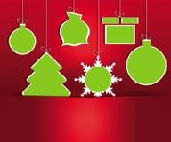 Игрушки рождества на красной предпосылке Стоковые Фотографии RF