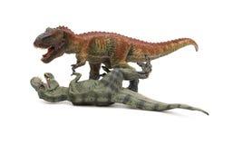 2 игрушки тиранозавра на белой предпосылке Стоковая Фотография