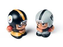 Игрушки товарищей по команде Lil Steelers и рейдовиков стоковые фото