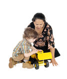 Игры няни с мальчиком стоковая фотография