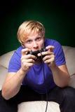 игры укомплектовывают личным составом играть видео- детенышей Стоковое Изображение
