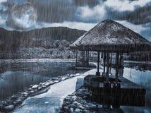 Идите дождь лить на тихой деревне на ноче Стоковое Фото