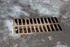 Избавление дождевой воды на улице Стоковое фото RF