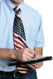 Избиратель патриота принимает список избирателей Стоковые Изображения