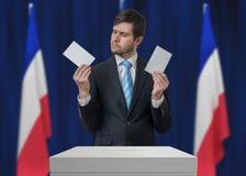 Избрание в Франции Нерешительный избиратель принимает решениее стоковые изображения rf