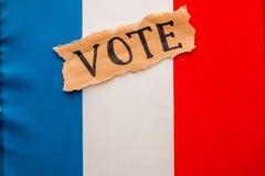 Избрания в Франции Голосование, надпись на сорванном бумажном листе Стоковая Фотография