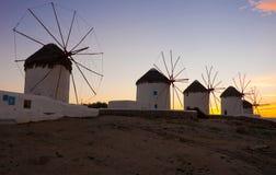известные ветрянки захода солнца номера mykonos Стоковая Фотография RF
