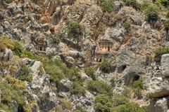 Известные усыпальницы Lycian старого города Caunos, Dalyan, Турции Стоковые Фото