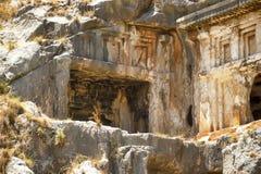Известные усыпальницы Lycian старого города Caunos, Dalyan, Турции Стоковые Изображения