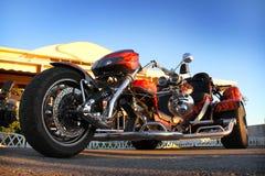 Изготовленный на заказ красный трицикл Стоковое Фото