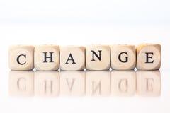 Измените, сказанный по буквам с письмами кости Стоковое Фото