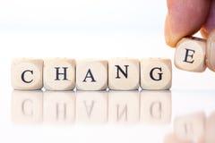 Измените, сказанный по буквам с письмами кости Стоковая Фотография