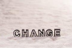 Измените слово на белом песке стоковое фото