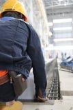 Измерение работника сидя Стоковые Изображения