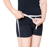 Измерение талии модели женщины в белой предпосылке Стоковая Фотография