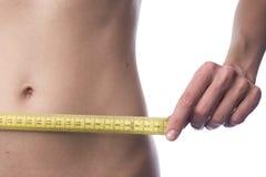 Измерения метра девушки стоковое фото rf