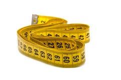измерьте желтый цвет ленты стоковое фото rf