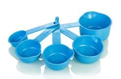 измерять изолированный чашками Стоковое Изображение