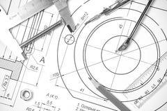 Измерять и чертежные инструменты в чертежах Стоковые Изображения