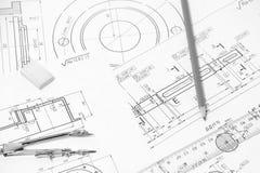 Измерять и чертежные инструменты в чертежах Стоковое Фото