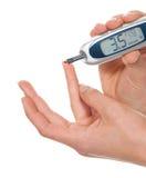 Измеряя анализ крови глюкозы ровный стоковые фото
