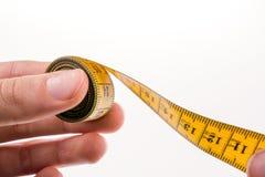 Измеряя лента в руке Стоковая Фотография