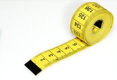 измеряя желтый цвет ленты Стоковые Фотографии RF