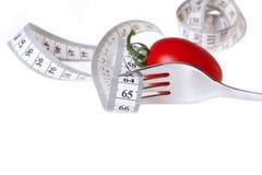 Измеряя лента - здоровая еда и диетпитание Стоковое Изображение