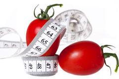 Измеряя лента - здоровая еда и диетпитание Стоковая Фотография
