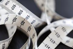 Измеряя лента портноя Крупный план, макрос Стоковое Изображение RF