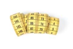 Измеряя лента портноя, шить желтая лента Стоковое Фото