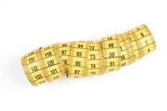 Измеряя лента портноя, шить желтая лента стоковые изображения