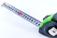 Измеряя лент-метр в черном зеленом цвете для измеряя длины стоковое изображение