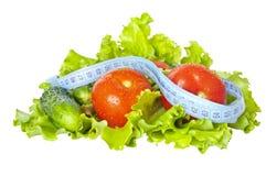 измеряя овощи ленты стоковые фото