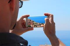 изображает принимать smartphone Стоковые Изображения