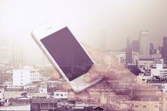 Изображение двойной экспозиции женщины используя мобильный телефон Стоковые Изображения