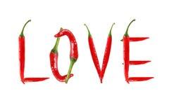 Изображение влюбленности слова написанной с перцами красного chili Стоковое Фото