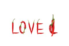 Изображение влюбленности слова написанной с перцами красного chili Стоковые Фотографии RF