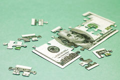 Изображение головоломки доллара принципиальная схема финансовохозяйственная Стоковое Изображение