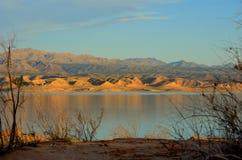 Заход солнца на мёде озера Стоковые Фото
