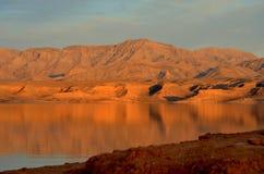 Заход солнца на мёде озера Стоковая Фотография