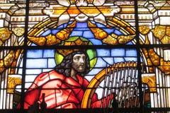Изображение значка на цветном стекле в католической христианской церков Стоковое Изображение RF