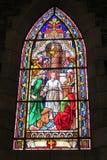 Изображение значка на цветном стекле в христианской церков Стоковое Изображение