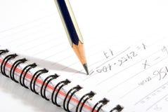 Изображение конца-вверх карандаша и тетради Стоковая Фотография RF