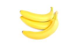 Изображение конца-вверх сочных, зрелых и ярких желтых бананов на белой предпосылке Красочные и освежая бананы витамины Стоковое Изображение RF
